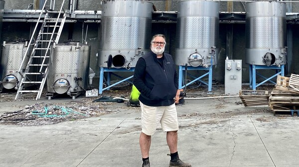 Owner and founder Jeff Smith in front of what remains of Hourglass' winery and processing facility in Napa. He's rebuilding, but wildfires have him re-thinking everything about his land and business.