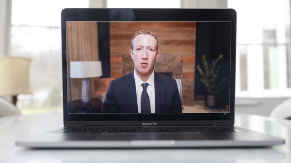 Mark Zuckerberg, CEO of Facebook, speaks virtually during a House Energy and Commerce subcommittee hearing in March.