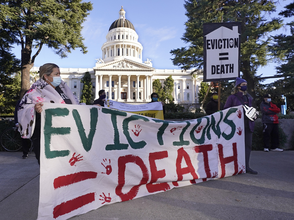 Protesters call for stronger eviction protections in January in Sacramento, Calif. A federal appeals court will now decide whether to scrap a federal eviction moratorium from the CDC. Housing groups say renters need more time to qualify for and get rental assistance money. (Rich Pedroncelli/AP)