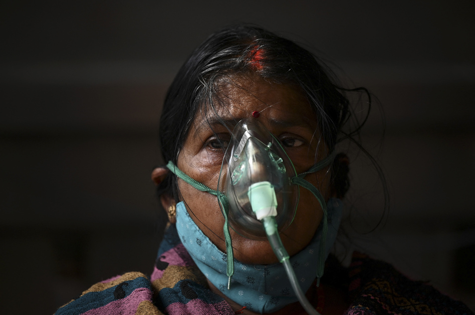 A patient breathes with the help of oxygen provided at a tent installed at a gurdwara, a place of worship for Sikhs, in Ghaziabad, India, on May 2.