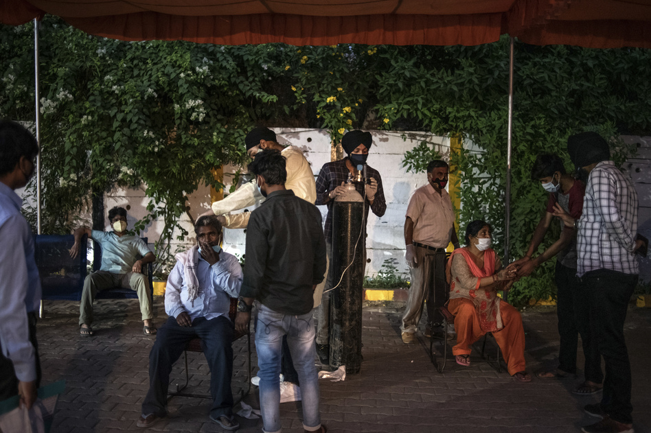 Volunteers provide free oxygen to COVID-19 patients at a makeshift clinic in a parking lot outside a Sikh house of worship on May 3 in New Delhi.