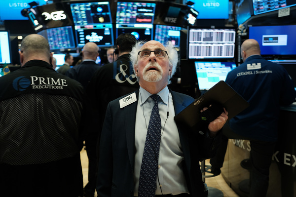 Stock trader Peter Tuchman works on the floor of the New York Stock Exchange on March 9, 2020.