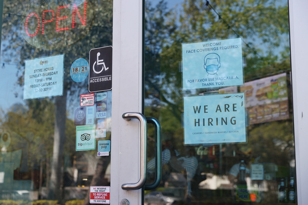 A 'we are hiring' sign in front of a store in Miami, Florida. Restaurants and other in-person business are looking to hire more workers as the U.S. jobless rate continues to fall.