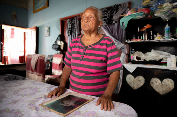 Edita Maldonado hosts a weekly radio program that tries to reunite migrants who disappeared on the dangerous trek north with their loved ones back in Progreso, Honduras.