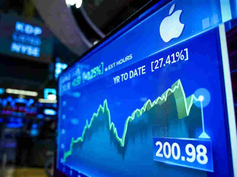 Stock numbers for Apple are displayed on a monitor on the floor of the New York Stock Exchange in August 2019.