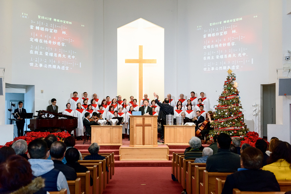 """In a scene from """"Suburban Chinatown,"""" Church-goers sing hymns during a Chinese-speaking service at Rowland Heights Christian Community Church."""