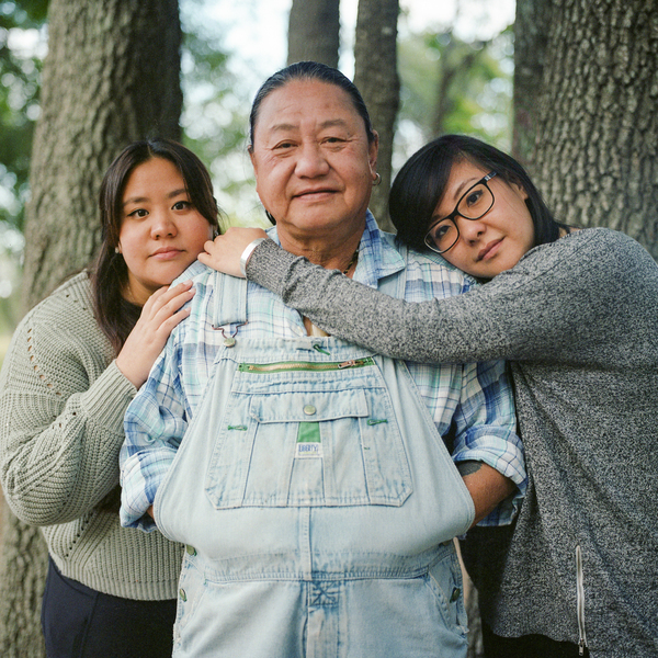 Marlon Chen, and his two daughters Victoria and Linda Chen, stand for a portrait. Marlon Chen immigrated to the United States in the 1980s from Taiwan and now runs a bonsai and rock shop off a state highway outside of Austin.