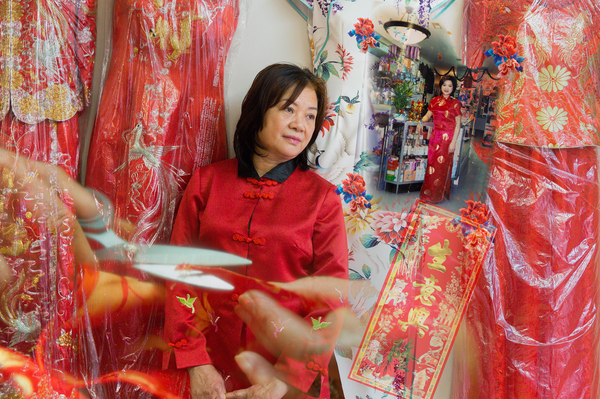 Lisa Lai (黎麗莎), 65, who now owns a cheongsam shop in Philadelphia's Chinatown, left Hong Kong to run a clothing factory in New York City, in 1994.