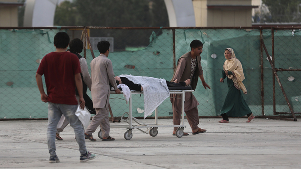 An injured school student is transported to a hospital after a bomb explosion near a school in Kabul, Afghanistan, on Saturday.