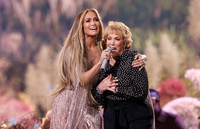 """Jennifer Lopez and her mother Guadalupe Rodríguez perform onstage during Global Citizen's """"Vax Live: The Concert To Reunite The World,"""" at SoFi Stadium in Inglewood, Calif."""