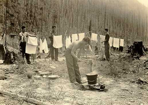 Clothes get washed and dried at a CCC camp near Apgar, Mont., at the foot of Lake McDonald in Glacier National Park.