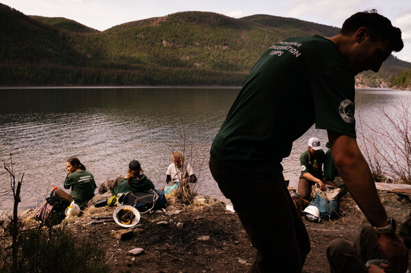 The Montana Conservation Corps crew breaks for lunch while spending the day working on  trails near Tally Lake.