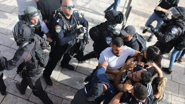 Undercover Israeli security force members arrest a Palestinian protester Monday at the Damascus Gate in Jerusalem.