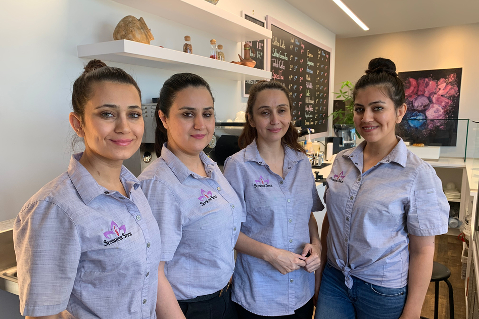 The Shams sisters at their Sunshine Spice Cafe in Boise, Idaho. From left: Narges, Khatera, Bahar (owner) and Homeyra. (Kirk Siegler/NPR)