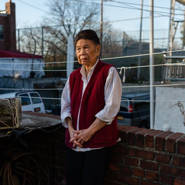 Juen Lee, 88, poses for a portrait on a patio in her home in Queens, New York