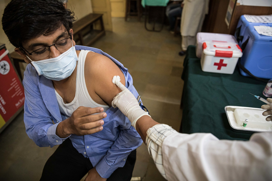 Amit Sonawane, 35, an engineer at a district health office, gets his first vaccine dose in Palghar, India. (Viraj Nayar for NPR)