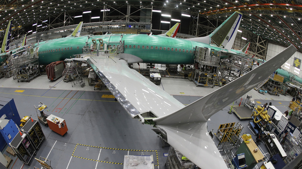 A Boeing 737 MAX 8 airplane sits on the assembly line at Boeing