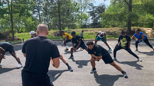 Stephen Ahlstrom's 90-minute weekly workouts ultimately helped Marcus Robinson (front) drop 65 pounds by March. He's now enlisted and starts basic training this month.