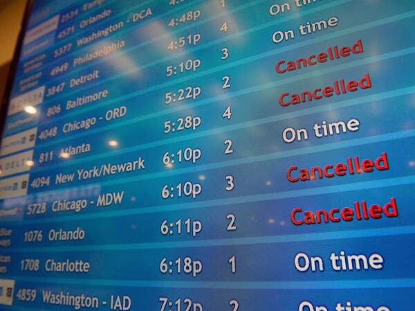 A screen shows canceled incoming flights at T.F. Green International Airport in Warwick, R.I., on March 30, 2020. Consumer advocates and two senators say airlines are sitting on nearly $15 billion in refunds owed to customers for canceled travel.