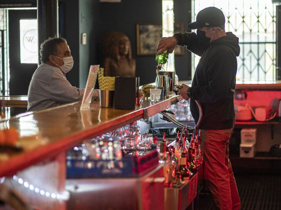 A bartender mixes a drink inside a bar last week in San Francisco. The latest retail sales data out on Friday showed an increase in sales at restaurants and bars as more people venture out amid the continued reopening of the U.S. economy. (David Paul Morris/Bloomberg via Getty Images)