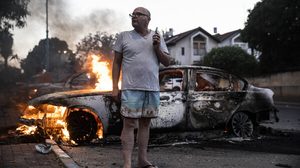 Jacob Simona stands by his burning car during clashes between Palestinian citizens of Israel and police in the Israeli mixed city of Lod on Tuesday.