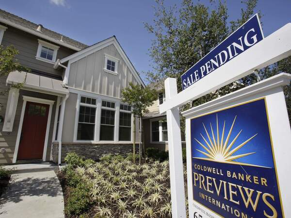 A record shortage of homes for sale and strong demand from buyers are sparking bidding wars and sending home prices to new records.