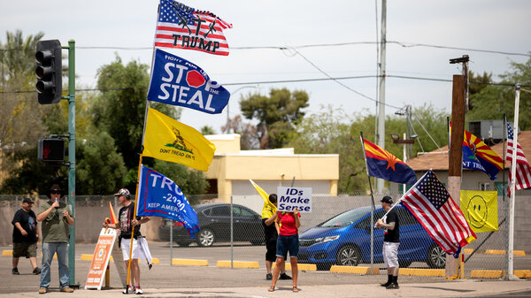 Demonstrators in support of former President Donald Trump gather on May 1 outside the Arizona Veterans Memorial Coliseum in Phoenix, where a controversial 2020 general election review was set to begin. Trump has heartily supported the audit.