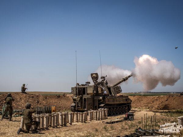 Israeli artillery fires toward the Gaza Strip from a position at the Israeli-Gaza border near Sderot on Wednesday.