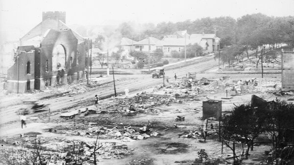 Buildings were destroyed in a massive fire during the Tulsa Race Massacre when a white mob attacked the Greenwood neighborhood, a prosperous Black community in Tulsa, Okla., in 1921. Eyewitnesses recalled the specter of men carrying flaming torches through the streets to set fire to homes and businesses.