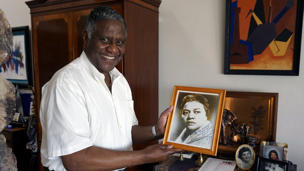 Arnett Moore holds of photo of his late aunt, actress Juanita Moore. He's determined to get Juanita a star on the Hollywood Walk of Fame.