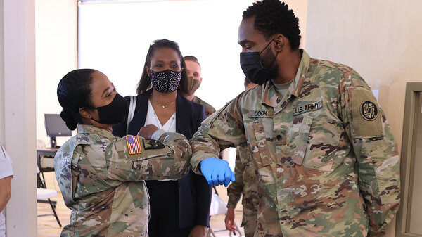 Nearly 130 million U.S. adults have completed their vaccine regimens, the CDC says, with another 70 million vaccine doses currently in the distribution pipeline. Here, Maryland National Guard Brig. Gen. Janeen Birckhead greets soldiers last week at a mobile vaccine clinic in Wheaton, Md.