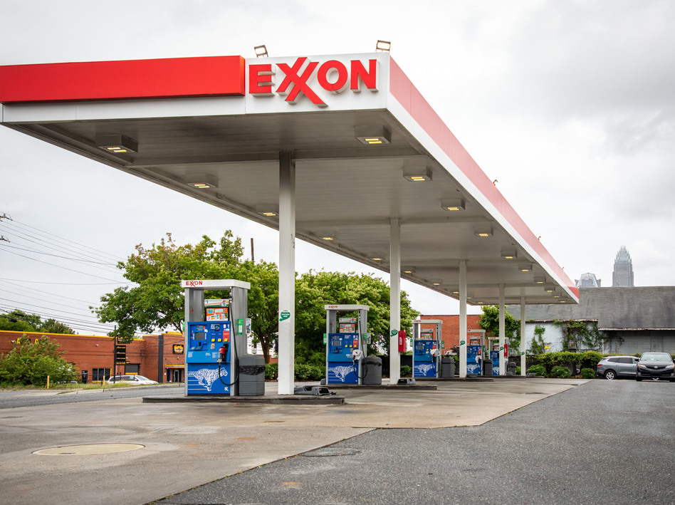 Pictured are pumps at an Exxon gas station in Charlotte, N.C. A tiny fund got two board members elected to the oil giant's board, delivering a historic defeat to ExxonMobil. (Logan Cyrus/AFP via Getty Images)