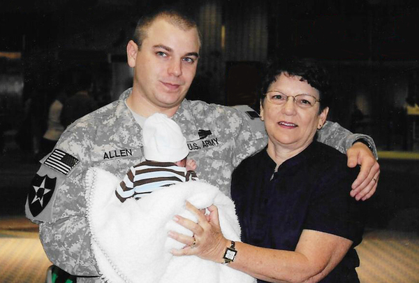 Cathy Sprigg with her son, Army Spc. Robert Joseph Allen, at Tampa International Airport in 2010. At the time, Allen was headed back to Iraq after being on leave for the birth of his son.