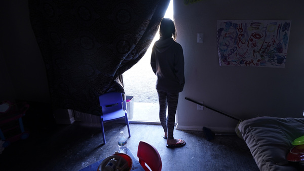 In February this year, Ricki Mills looks out from her Dallas home as she waits for a fire hydrant to be turned to get water. Texas lawmakers have approved a package of measure aimed at addressing what went wrong during one of the worst power outages in U.S. history.