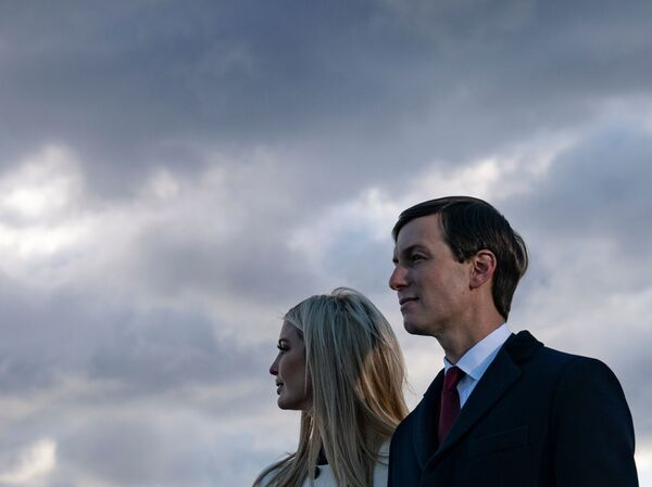 Ivanka Trump, daughter of former President Donald Trump, and her husband Jared Kushner stand on the tarmac at Joint Base Andrews as they attend Trump's departure Jan. 20.