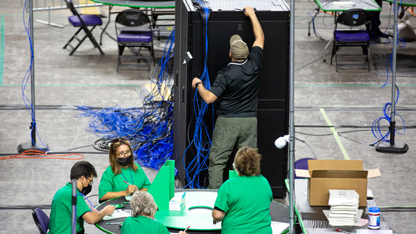 Contractors working for Cyber Ninjas, the company hired by the Republican-led Arizona state Senate, examine and recount ballots from the 2020 general election on May 3.