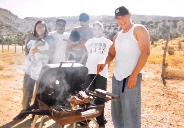 Carlos Yazzie grills with his family.
