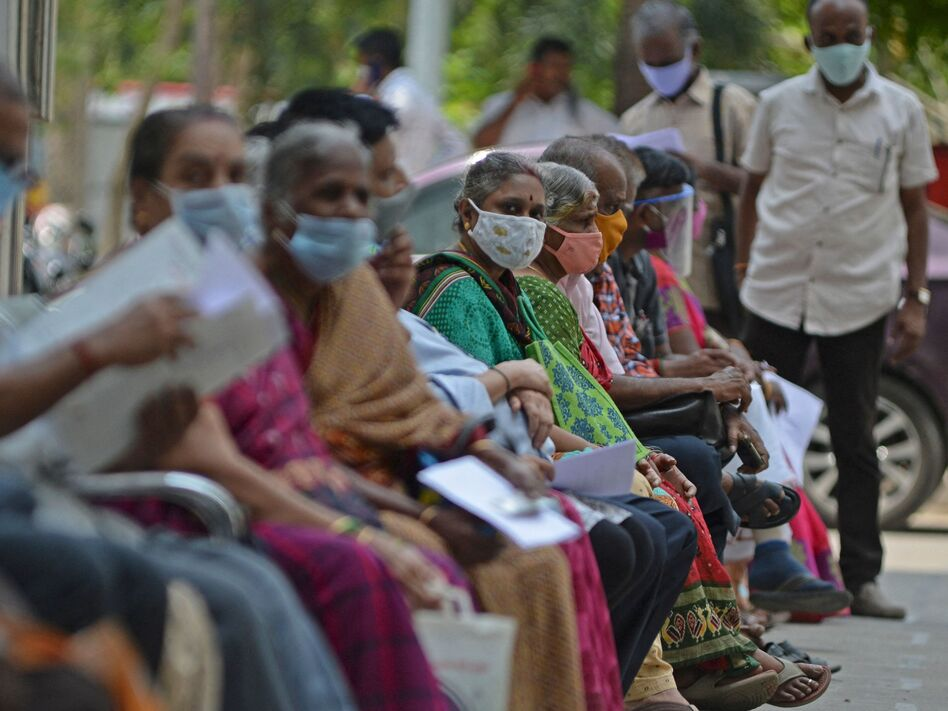 People wait their turn to receive the COVID-19 vaccine at a hospital in Chennai, India, in April. India is among the nations that will receive surplus U.S. vaccine through the international distribution system COVAX, the White House announced. (Arun Sankar/AFP via Getty Images)