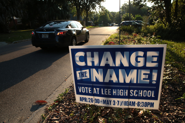 A sign in a yard close to Robert E. Lee High School calls for changing the school's name. The signs could be seen scattered throughout the neighborhoods surrounding the school.