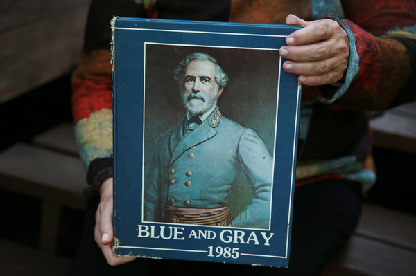 Julie Moore holds her 1985 yearbook with a portrait of Robert E. Lee on the cover.
