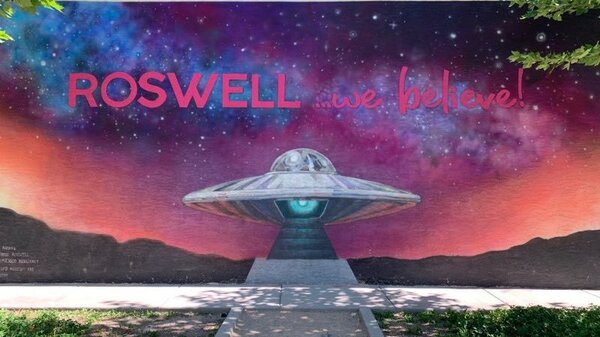 A mural in Roswell, N.M., displays the town slogan. A mysterious aircraft crash in 1947 led to the local legend of visitors from another planet.
