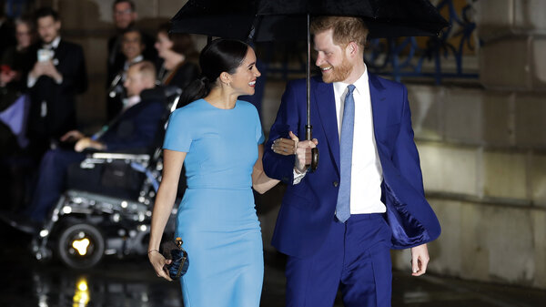 """Britain's Prince Harry and Meghan, the Duke and Duchess of Sussex, arrive at the annual Endeavour Fund Awards in London on March 5, 2020. The couple welcomed their second child, Lilibet """"Lili"""" Diana Mountbatten-Windsor, on Friday, a spokesperson for said."""