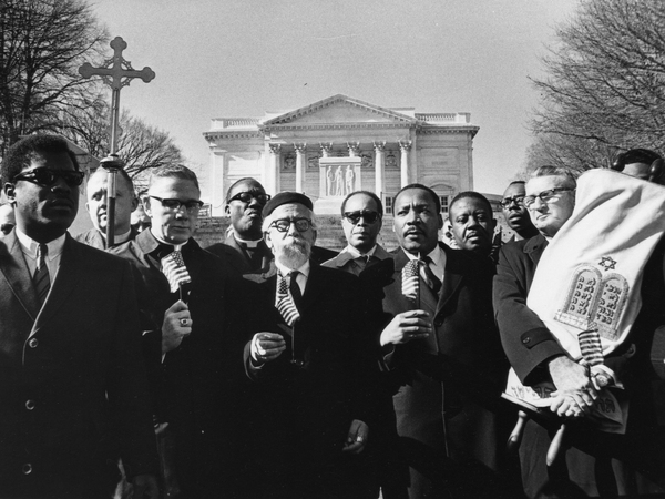 Rabbi Abraham Heschel (center) and Martin Luther King Jr. stand with (from left) Bishop James Shannon and Rabbi Maurice Eisendrath during a protest at the Tomb of the Unknown Soldier in Arlington National Cemetery on Feb. 6, 1968.