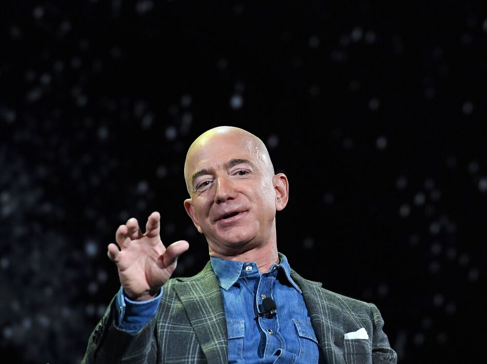 Amazon founder and CEO Jeff Bezos announced he'll be on board a spaceflight next month in a capsule attached to a rocket made by his space exploration company Blue Origin. Bezos is seen here in 2019. (Mark Ralston/AFP via Getty Images)