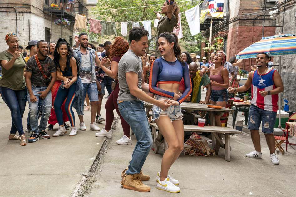 Anthony Ramos and Melissa Barrera play Usnavi and Vanessa in the film <em>In the Heights.</em> (Warner Bros.)