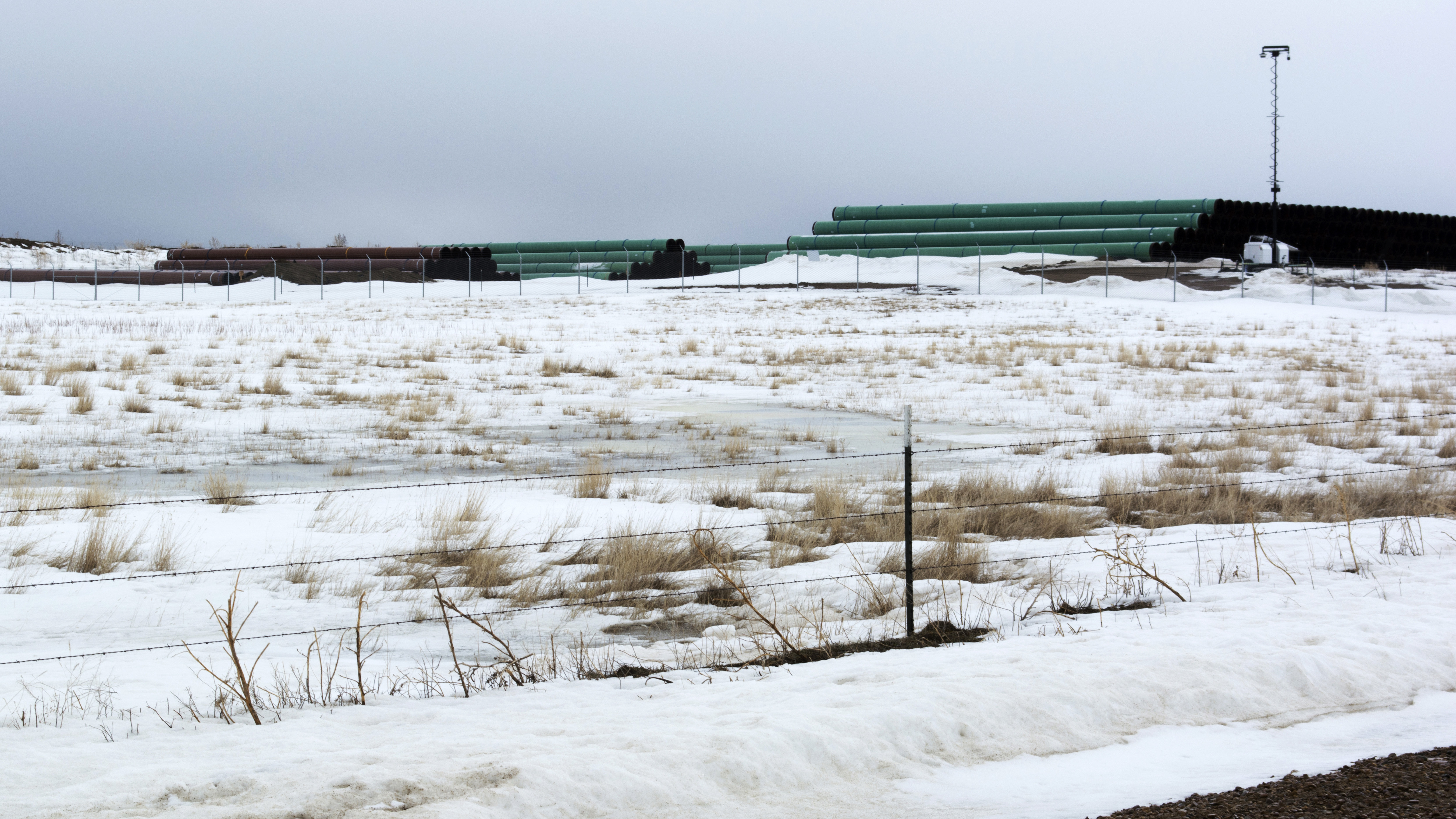 A storage yard in Montana contains pipe that was to be used in the construction of the Keystone XL oil pipeline. The developer has now canceled the controversial project.