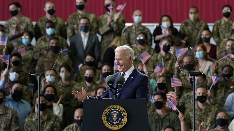 President Biden addresses U.S. service members Wednesday at Royal Air Force Mildenhall in Suffolk, England, on the first stop of his first overseas trip as president. (Patrick Semansky/AP)
