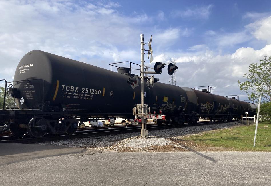 A freight train rolls through Bay St. Louis. April 27, 2021. (Stephan Bisaha/Gulf States Newsroom)