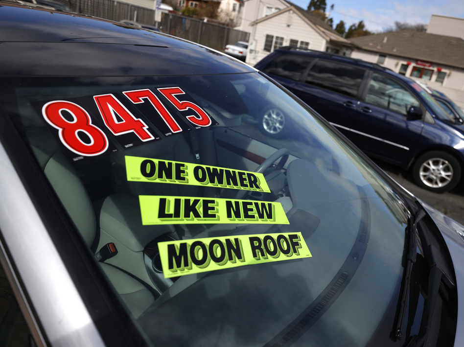Used cars sit on the sales lot at Frank Bent's Wholesale Motors in El Cerrito, Calif., on March 15. Supply chain snarls and pent-up demand are driving up the prices of a lot of things, including new and used cars. (Justin Sullivan/Getty Images)