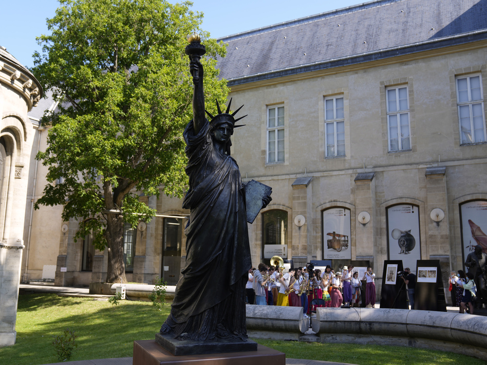 A mini replica of the French-designed Statue of Liberty will reach the U.S. on July 1. Here, the statue awaits its move in Paris on Monday. (Francois Mori/AP)